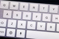 Qwerty keyboard in electronic device close up Stock Photos