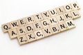 Qwerty scrabble keyboard wooden made from the game pieces Royalty Free Stock Photos