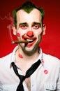 Rökande cigaro för clown 库存照片