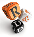R d orange black dice blocks research and development on white background clipping path included Royalty Free Stock Images