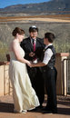 Rabbi blessing lesbian marriage ceremony in desert Stock Image