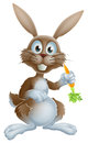 Rabbit with carrot cute cartoon bunny or easter bunny holding a and looking at viewer Royalty Free Stock Image
