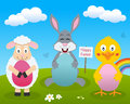 Rabbit chick lamb with easter eggs a cute happy greeting card a bunny a and a holding in a meadow flowers and the Stock Photos