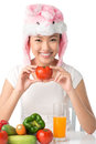 Rabbit food cute girl wearing a hat enjoying healthy diet Royalty Free Stock Photo