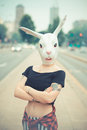 Rabbit mask woman in the city Royalty Free Stock Photo