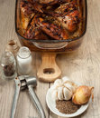 Rabbit meat roaster with onion cumin and garlic on wooden vintag vintage table Stock Image