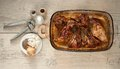 Rabbit meat roaster with onion cumin and garlic on wooden vintage table Stock Image