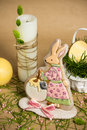 Rabbit shaped easter honey-cake, candles on holiday spring table Royalty Free Stock Photo