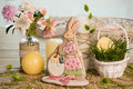 Rabbit shaped easter honey-cake, grass, holiday spring decorated table Royalty Free Stock Photo