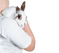 Rabbit white hold on shoulder isolated on white hand cute spotted bunny background Royalty Free Stock Photos