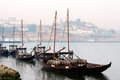 Rabelo boats porto portugal march traditional of the river douro anchored in a pier of gaia twin city of porto in a foggy morning Royalty Free Stock Image