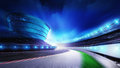 Race track bended road with stands and spotlights Royalty Free Stock Photo