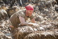 Racer crawling through electric obsticle obstacle at the tough mudder competition in mansfield ohio on april this race was Stock Photography