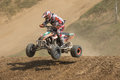 Racer is jumping a quad bike Royalty Free Stock Photo