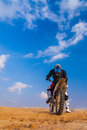 Racer on a motorcycle in the desert day Royalty Free Stock Photo