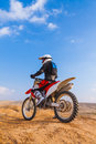 Racer on a motorcycle in the desert summer day Royalty Free Stock Photo