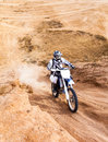 Racer on a motorcycle ride in the desert mountain in summer Royalty Free Stock Photography