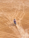 Racer on a motorcycle ride through the desert in summer Stock Photo