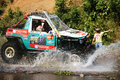Racer off road at terrain racing car competition bao loc vietnam feb motor cross stream that extreme with rock on water competitor Stock Image