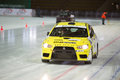 Racing car on ice in sports complex Royalty Free Stock Photo
