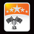 Racing flags and trophy on orange star backdrop Stock Images