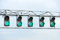 Racing green traffic light on background sky Stock Image