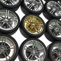 Racing tires with chrome and gold rims Royalty Free Stock Photo