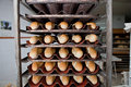 Rack with baguettes Royalty Free Stock Photo