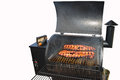 Rack of barbeque ribs on the grill Royalty Free Stock Photo
