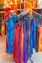 Rack of brightly colored summer dresses