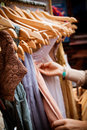 Rack of dresses at market recession bargains second hand for sale portrait orientation Royalty Free Stock Photo
