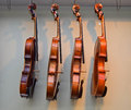 Rack of hanging violins 2 Royalty Free Stock Photo