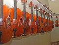 Rack of hanging violins 5 Royalty Free Stock Photo