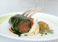 Rack of lamb encrusted in mint wrapped a crust Royalty Free Stock Image