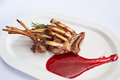 Rack of lamb with raspberry jam Royalty Free Stock Photo