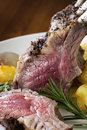 Rack of lamb with rosemary and roasted potatoes tight crop Royalty Free Stock Photography