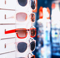 Rack with sunglasses closeup of Royalty Free Stock Photos