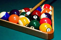 Racked pool balls, cue stick Stock Photo