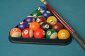 Racked pool billiard balls or with a cue on green felt Stock Photos