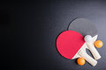 Racket table tennis with ping pong ball on black background.Spor Royalty Free Stock Photo
