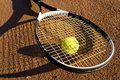 A racket and a tennis ball Royalty Free Stock Photos