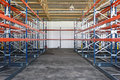 Racks and shelves empty in distribution warehouse Stock Images