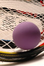 Racquetball purple and racquet Stock Photo
