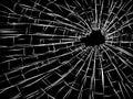 Radial cracks on broken glass. Royalty Free Stock Photo