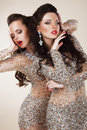 Radiance glam luxurious rich women in grey dresses with rhinestones couple of fashion young gray dancing Stock Images