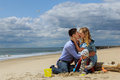 Radiant family at the beach parents with son on playing Royalty Free Stock Image