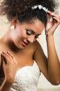 Radiant hispanic bride wearing a white dress Royalty Free Stock Photo