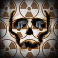 Radiation concept and nuclear power plant risk metaphor as a human skull face icon burning a radioactive hole exposing atomic Stock Image