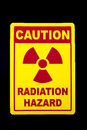 Radiation hazard a sign against a black background Stock Image