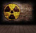 Radiation sign on a brick wall Royalty Free Stock Photos